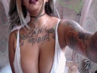 tattoo_ninja_kitty young cam girl with an ohmibod slutting it up live on camera