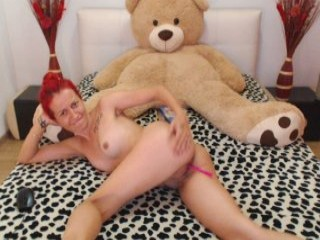 catwoman90 redhead young cam girl being naughty and seductive on a live webcam