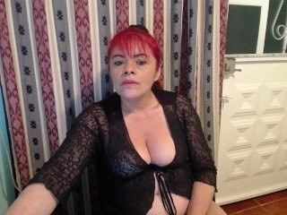 sexititshot12 redhead mature cam girl being naughty and seductive on a live webcam