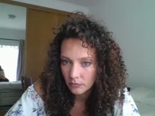 milflucy MILF cam girl broadcasts live sex via webcam