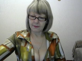 jkotenok mature cam girl with a hairy pussy teasing it on a sex cam