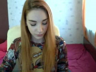 gingerpretty redhead teen being naughty and seductive on a live webcam